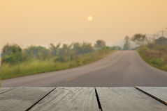 Defocus and blur image of terrace wood and asphalt road through Stock Photography