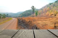 Defocus and blur image of terrace wood and road for background u. Sage Stock Photo