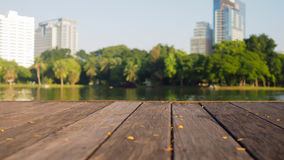Defocus and blur image of terrace wood and water  Royalty Free Stock Image