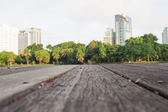 Defocus and blur image of terrace wood and water, trees and building inside. Park view in the city, natural background Stock Photo