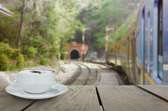 Defocus and cappuccino coffee with train into tunnel Royalty Free Stock Images