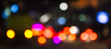 Defocus Car Tail Lights in The Night. Traffic. The shot was taken by altering the lens focus ring stock photos