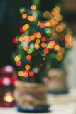 Defocus Christmas Tree. Defocused Christmas Tree with light decorative garland Stock Image