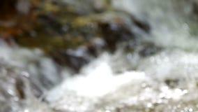 Defocus footage of the water flow stock footage