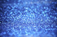defocus of glitter  lights background. blue,white and black for Christmas and new year background. Stock Photography