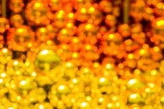 Background of blurred glass Christmas balls yellow color royalty free stock images
