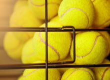 Image of Close up view of balls in basket on clay tennis court. Focus on balls stock photos