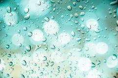 Defocus of light with blue background. Defocus of light with blue  background and drop water Royalty Free Stock Image
