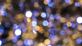 Defocus Light. Christmas background. Festive elegant abstract background with bokeh lights and stars Stock Photos