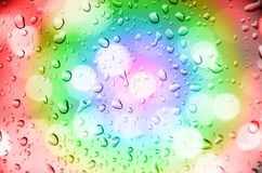Defocus of light with multicolor  background. And drop water Stock Photography