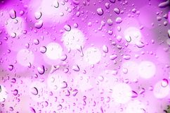 Defocus of light with violet background. And drop water Stock Photo
