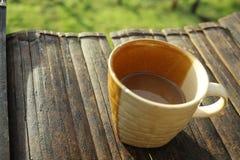 Defocus oc een kop van koffie stock afbeelding