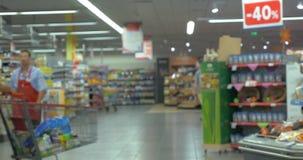 Defocus of people shopping in supermarket stock video