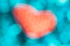 Defocus red heart  and blue bokeh background. Royalty Free Stock Photography
