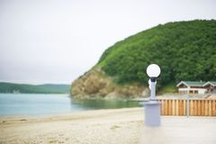 Defocus seashore summer landscape saturation water pebble nature hill Bay. The natural background of the sea royalty free stock image
