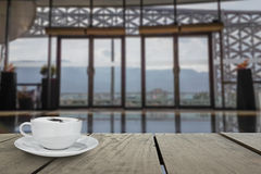 Defocus with terrace wood and cappuccino coffee with entrance ha Stock Photography