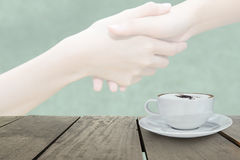 Defocus with terrace wood and cappuccino coffee with fade out of  handshake Royalty Free Stock Photography