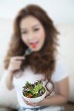 Defocus Young beautiful women holding a bowl of salad. Defocused Young beautiful woman holding a bowl of salad Stock Images