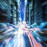 defocused大城市夜的交通抽象背景  库存照片