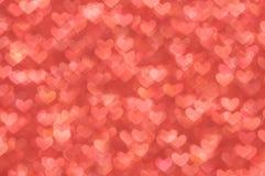 Defocused抽象红色心脏轻的背景 免版税库存照片