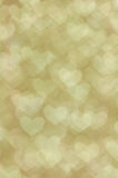 Defocused抽象金黄心脏轻的背景 免版税库存图片
