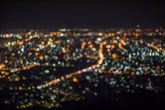 Defocused抽象ChiangMai市夜点燃背景 免版税图库摄影