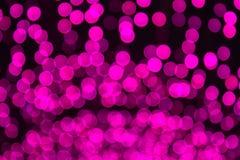 Defocused桃红色和紫色点燃背景照片 免版税库存照片