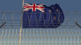 Defocused развевая флаг Новой Зеландии за загородкой колючей проволоки 3D анимация Loopable видеоматериал