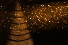 Defocused абстрактная предпосылка светов золота и черноты стоковые фотографии rf