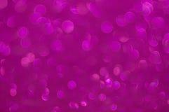 Defocused абстрактная фиолетовая светлая предпосылка Стоковая Фотография