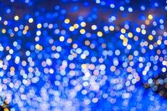 Defocused городская абстрактная текстура, света bokeh города освещает внутри Стоковая Фотография