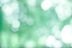 Defocused зеленый цвет предпосылки светов Стоковые Изображения RF