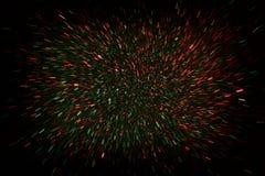 Defocused конспект красного цвета и зеленые светы разрывали предпосылку Стоковая Фотография