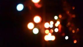 Defocused моргать гирлянда запачканная конспектом Bokeh предпосылки светов моргать видеоматериал
