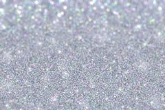 银色闪烁有色的微粒defocused背景 库存图片