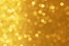 Яркий блеск золота Defocused Стоковые Фото