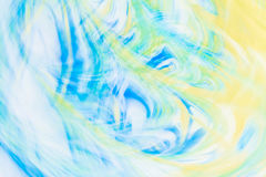 Defocused abstract background with a predominance of yellow and blue flowers, art Royalty Free Stock Photos