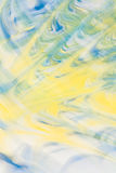 Defocused abstract background with a predominance of yellow and blue flowers, art Stock Image