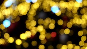 Defocused abstract background of a spinning christmas tree and bokeh lights. Defocused abstract background of a rotating Christmas tree and bokeh lights stock video