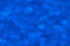 Defocused abstract blue hearts light background. Blue heart lights abstract background Royalty Free Stock Image