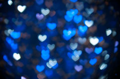 Defocused abstract blue hearts light background. Blue heart lights abstract background Stock Photo