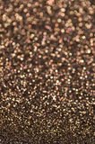 Defocused abstract brown lights background. Brown glitter texture christmas abstract background Stock Photo