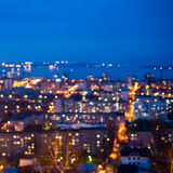 Defocused abstract city lights in the twilight with river, refle Royalty Free Stock Images