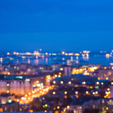 Defocused abstract city lights in the twilight with river, refle Stock Photography