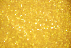 Defocused abstract gold lights stock images