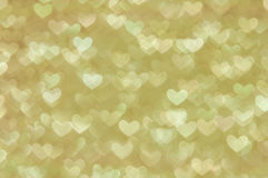 Defocused abstract golden hearts light background Stock Photos