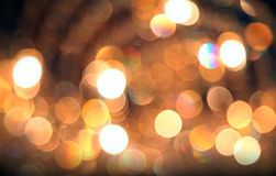 Defocused abstract golden lights background. Natural bokeh patten Royalty Free Stock Images