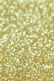Defocused abstract golden lights background Stock Image