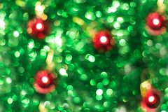 Defocused abstract green background with red. Blurred holiday bokeh Stock Photos