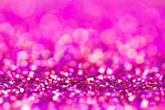 Defocused abstract holidays lights on background. Purple glitter background Royalty Free Stock Photography